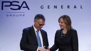 Carlos Tavares, Chairman of the Managing Board of French carmaker PSA Peugeot Citroen, shakes hands with Mary Barra, chairwoman and CEO of General Motors, before a news conference in Paris