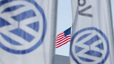 An American flag flies next to a Volkswagen car dealership in San Diego, California